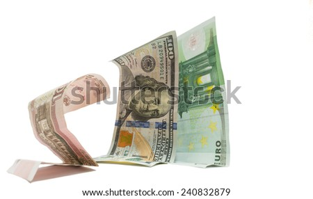 Russian currency ruble is standing on knees before dollar and euro as a metaphor of sanctions  - stock photo
