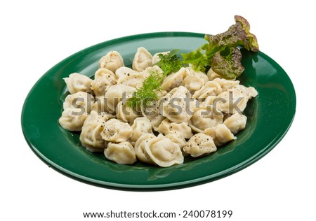 Russian dumplings with dill and pepper - stock photo