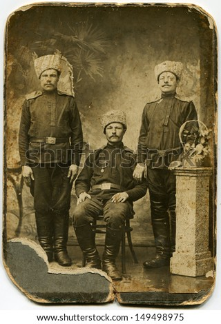 RUSSIAN EMPIRE - CIRCA 1910s: Studio portrait of studio portrait of three soldiers, 1910s