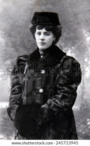 RUSSIAN EMPIRE - CIRCA 1917: Vintage photo of a young noblewoman in luxury fur coat - stock photo