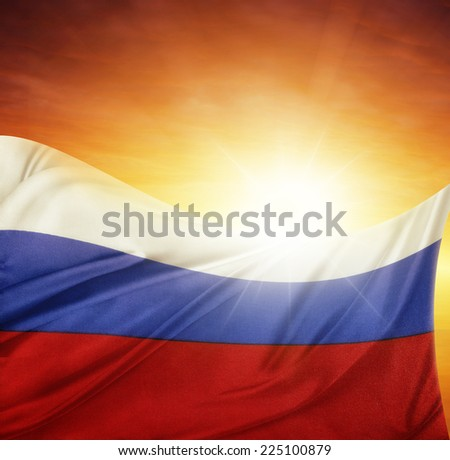 Russian flag in front of bright sky - stock photo