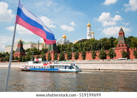 Russian flag on the background of the Moscow Kremlin and Moscow River in Moscow