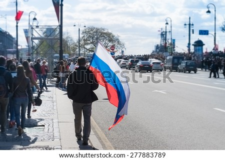 Russian flag waving in hand man on the street. - stock photo