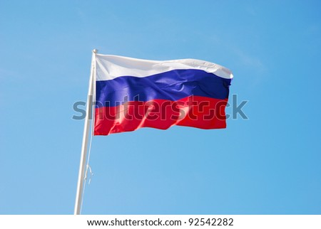 Russian flag waving in the wind - stock photo