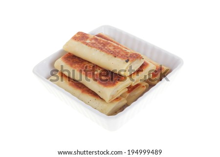 russian food - pancake with various fillings served in white bowl isolated over white background