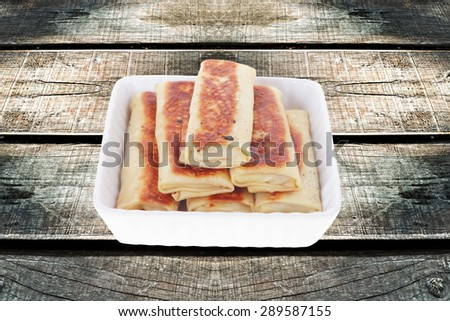 russian food - pancake with various fillings served over old style wooden table - stock photo