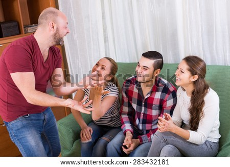 Russian friends hanging out with beer and jokes at home