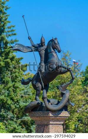 Russian Georgy victorious kill the snake monument with federation flag at background