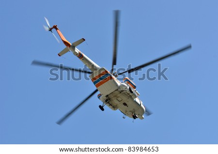 Russian helicopter Mi-17 flying on the blue sky - stock photo