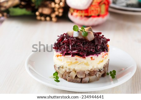 Russian herring salad on a white plate for holiday - stock photo
