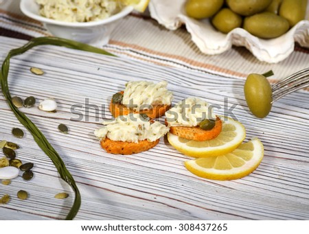 Russian kitchen. Roasted baguette toast with olive butter snack
