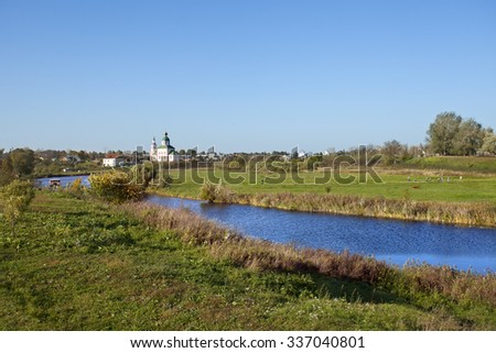 Russian landscape with river Kamenka and Church in Suzdal. Golden Ring of Russia - stock photo