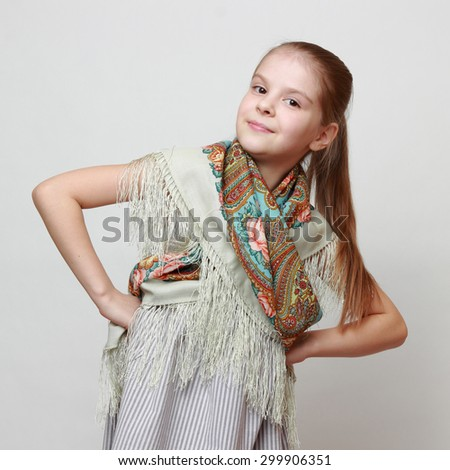 Russian little girl in traditional Pavloposadskij scarf dancing