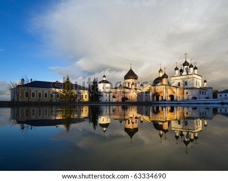 Russian monastery in Moscow region, spring, sunset - stock photo
