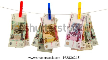 Russian money hangs on clothespins is isolated on white a background