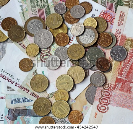 Russian money (paper and coin) on the table, top view. Rubles and kopecks. A small amount of money.