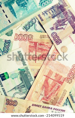 Russian money. Rubles banknotes vintage instagram toned photo texture - stock photo