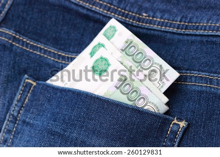 Russian money rubles in blue jeans pocket as a top view image
