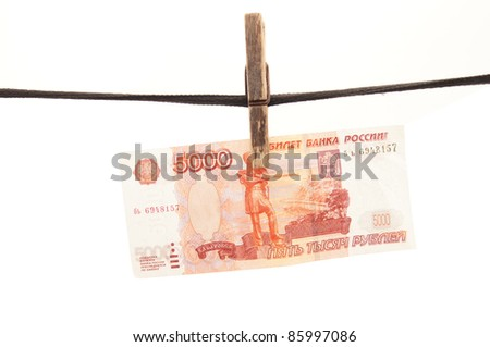 Russian money to hang on a rope - stock photo
