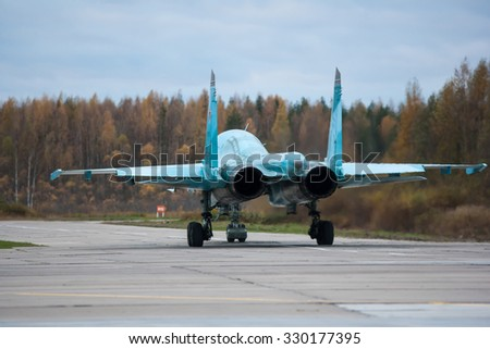Russian multi-purpose fighter-bomber Su-34 on the runway airport - stock photo