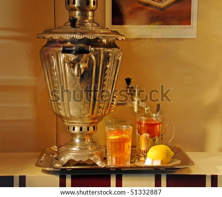russian national metallic samovar with tea glasses