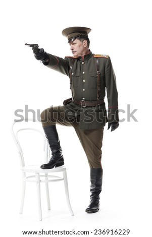russian officer with gun isolated on white