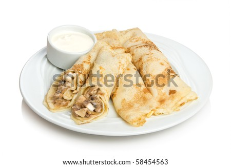 Russian pancakes stuffed by mushroom sauce. Isolated on white by clipping path.