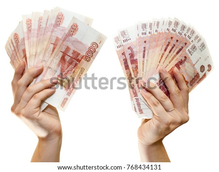 Russian paper banknotes 5000 rubles in two hands isolated on white background