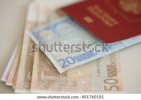 Russian passport and Euro banknotes