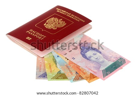 Russian passport and pile of money of Venezuela are isolated on a white background