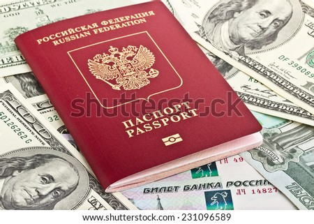 Russian passport on a background of the American and Russian money
