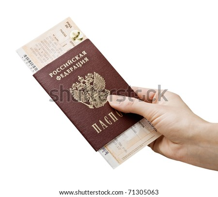 Russian passport with an attached train tickets - stock photo