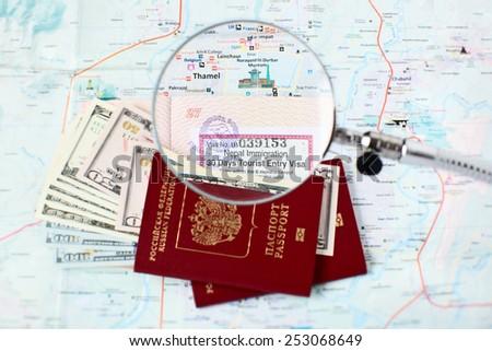 Russian passports and Kathmandu city map - focus on open tourist visa and Thamel - centre of the tourist industry in Kathmandu - stock photo
