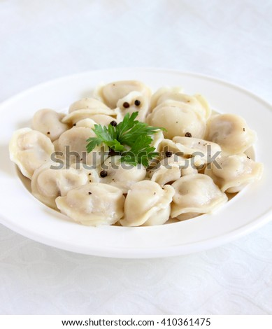Russian  pelmeni with bell pepper,parsley isolated on white - stock photo