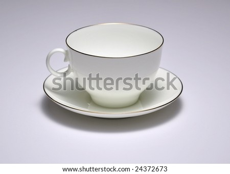 Russian porcelain cup and saucer with golden rim - stock photo