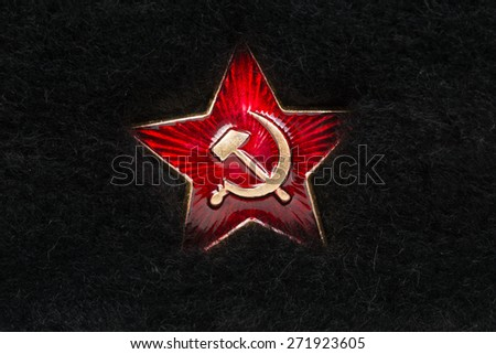 Russian Red Star with Hammer and Sickle on Fur - stock photo