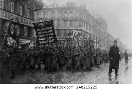 Russian Revolution. Funeral of 182 persons killed by Czarist police on Feb. 26, 1917. Crowd with banners in the street, St. Petersburg, Russia. - stock photo