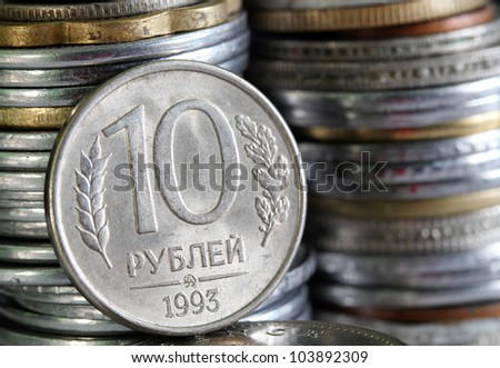 Russian rouble or ruble currency coin with stack of coins piled in the background - stock photo