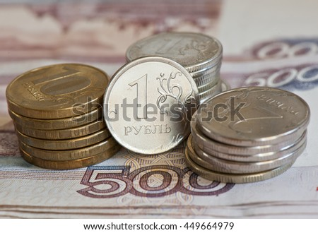 Russian roubles coins against 500 roubles background