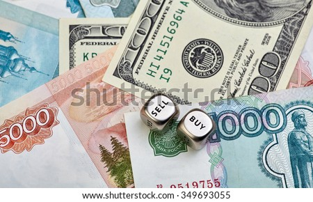 Russian Ruble, US Dollar and dices cubes. Selective focus - stock photo