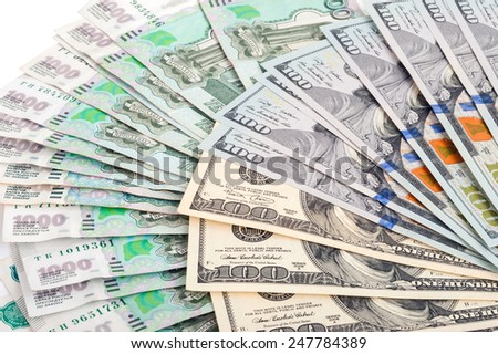Russian rubles and US dollars - stock photo
