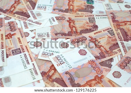 Russian rubles banknotes and coins - stock photo