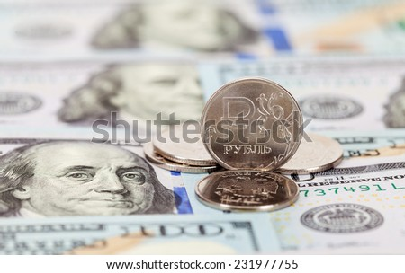 Russian rubles coins and dollars banknotes close up - stock photo