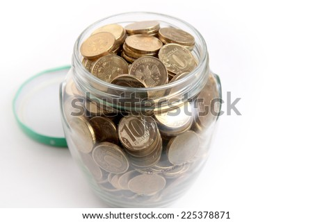 russian rubles in glass bank as element accumulation - stock photo