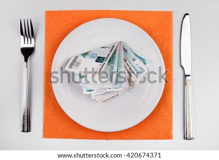 Russian Rubles in the Plate on the Table - stock photo