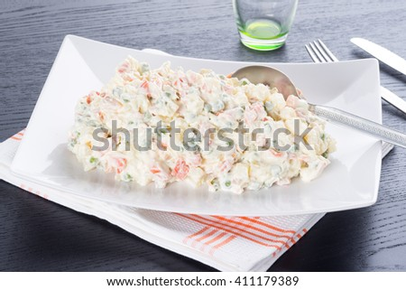 Russian salad plate homemade served on the table - stock photo