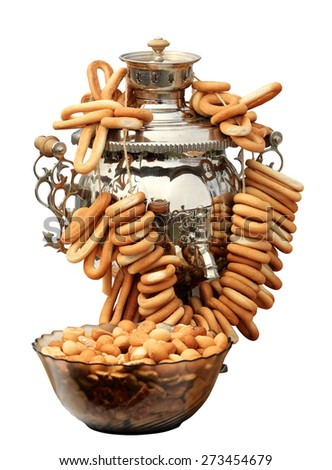 Russian samovar with bagels on the white background, isolate.  - stock photo