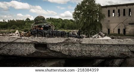 Russian sniper hidden in urban area - stock photo