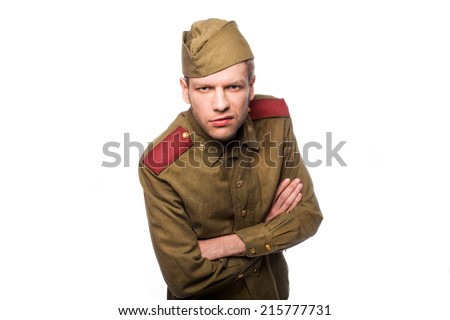 Russian soldier angry looking. Studio portrait isolated on white background - stock photo