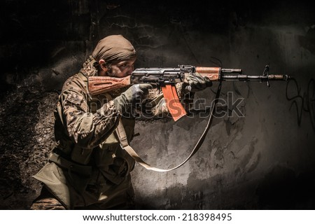 Russian soldier in urban area at night - stock photo